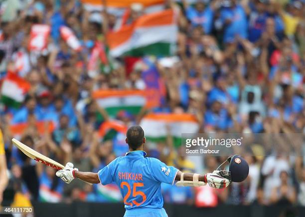 Indian fans in the crowd celebrate as Shikhar Dhawan of India reaches his century during the 2015 ICC Cricket World Cup match between South Africa...
