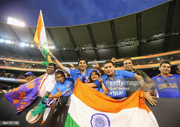 Indian fans in the crowd show their support during the 2015 ICC Cricket World Cup match between South Africa and India at Melbourne Cricket Ground on...