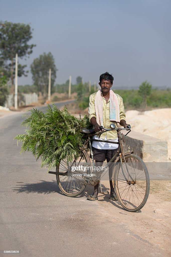 Indian Farmer riding a bicycle.