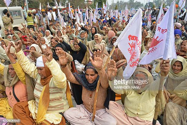 Indian farmers from Kisan Sangharsh Committee shout slogans during a protest against the Punjab State Electricity Regulatory Commission and the State...