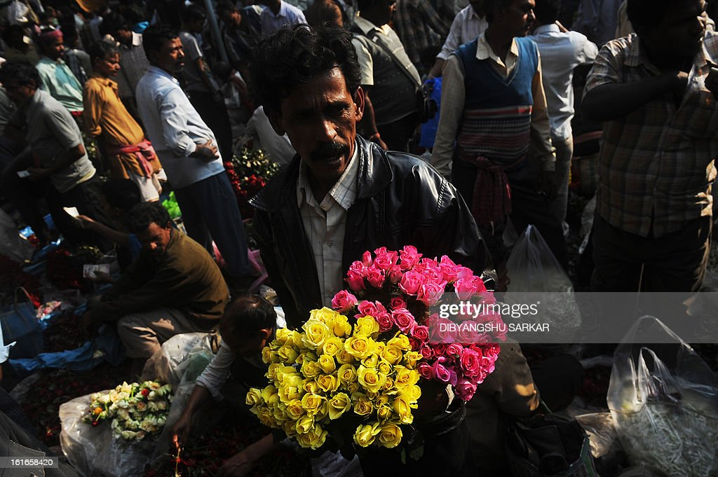 Indian farmers wait for customers at a wholesale flower market in Kolkata, on February 14, 2013. On Valentine's day the floriculture business in the city is booming because of the increased demand nationally. AFP PHOTO/ Dibyangshu SARKAR