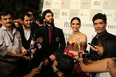 Indian fashion designer Manish Malhotra along with Bollywood actors Deepika Padukone and Fawad Khan on day 1 of FDCI India Couture Week 2016 at The...