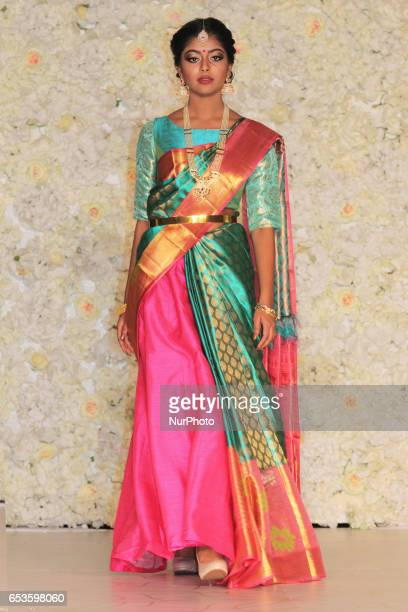 Indian fashion model wearing an elegant and ornate Kanchipuram saree during a South Asian bridal fashion show held on 14 March 2017 in Scarborough...