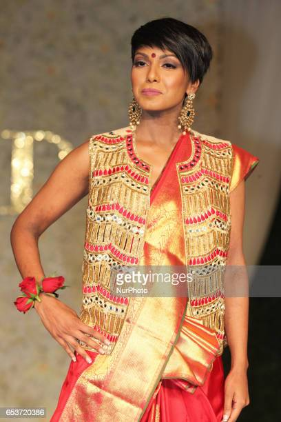 Indian fashion model wearing an elegant and ornate Kanchipuram saree and vest during a South Asian bridal fashion show held in Scarborough Ontario...