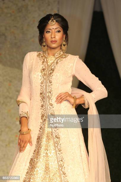 Indian fashion model wearing an elegant and ornate outfit during a South Asian bridal fashion show held in Scarborough Ontario Canada