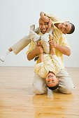 Indian father and sons playing