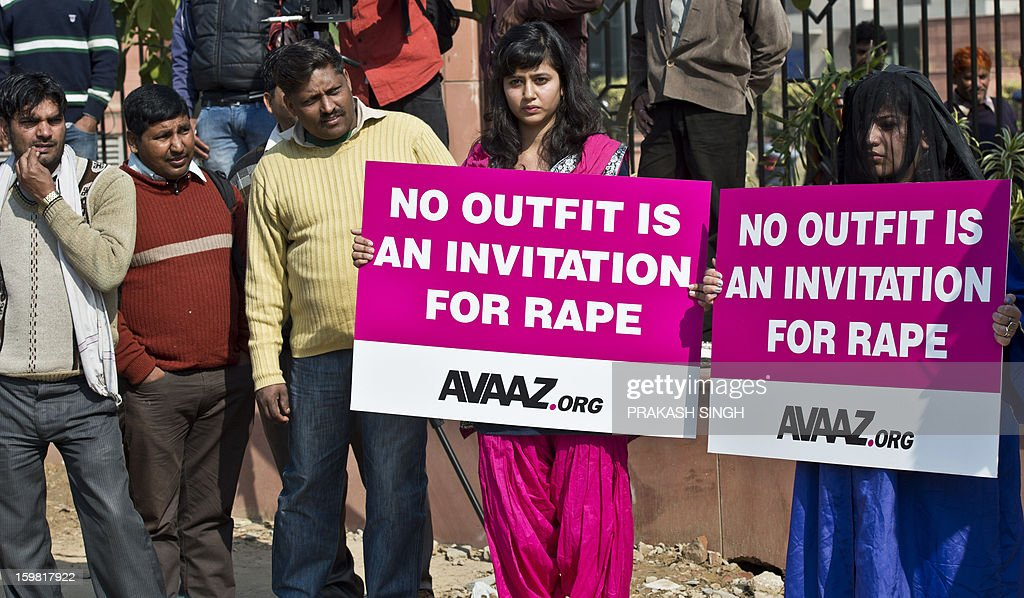 Indian female activists hold placards during a protest at the district court Saket in New Delhi on January 21, 2013. The father of a student who died after being gang-raped on a bus in New Delhi called for swift justice and for her attackers to be hanged as five men accused of her murder prepared to go on trial. A defence lawyer tried to persuade India's top court that the trial should be shifted out of the capital, but the father of the 23-year-old victim said her family would only rest once a fast-track court had handed down its verdict. AFP PHOTO/ Prakash SINGH