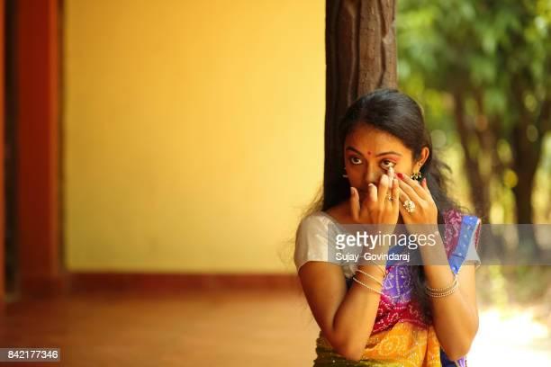 Indian Female Applying Kajal