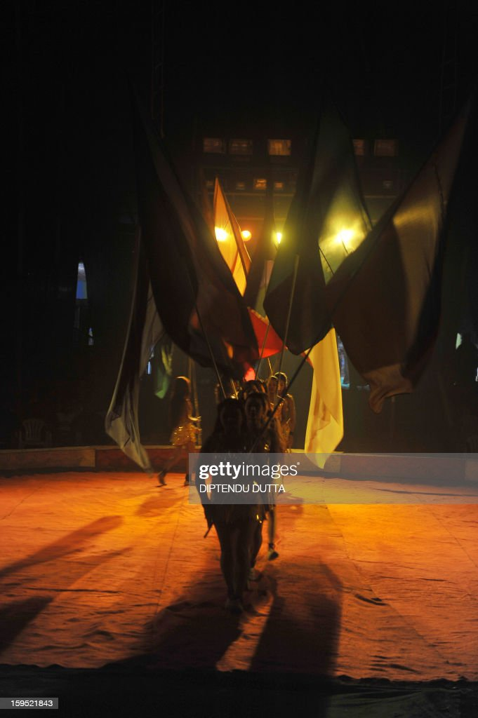 Indian female performers carry flags during a show at the Kohinoor Circus in Siliguri on January 14, 2013. The Kohinoor Circus, inaugurated in 1988, is one of the most popular as it travels throughout India. At present, there are only ten circuses still active in India whereas in the first half of the 20th century, there were as many as 50 circuses touring the country. AFP PHOTO/ Diptendu DUTTA