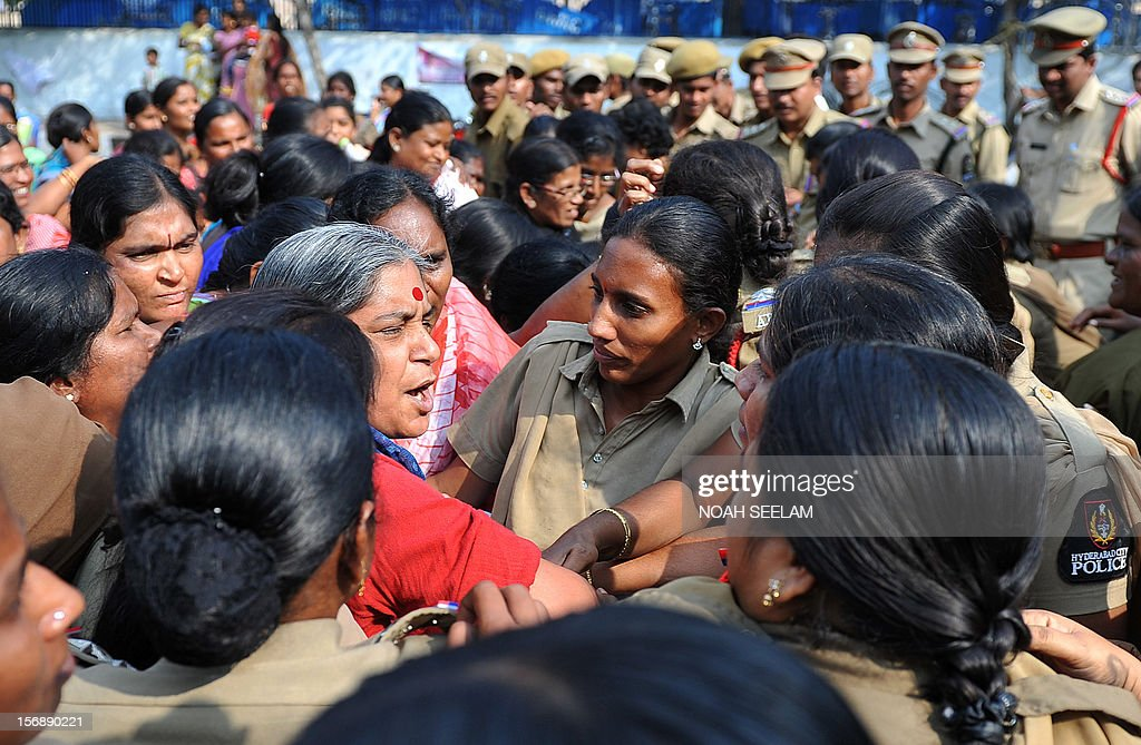 Indian female police detain the general secretary of National Federation of Indian Women (NFIW) Annie Raja (C) during a protest against the increasing violence against women in the country in Hyderabad on November 24, 2012. NFIW demands action against the recent rise of violence and oppression against women. AFP PHOTO / Noah SEELAM