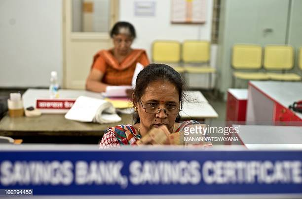 Indian female postal attendants work at the newly inaugrated 'All women employees post office' in New Delhi on April 11 2013 The post office will be...