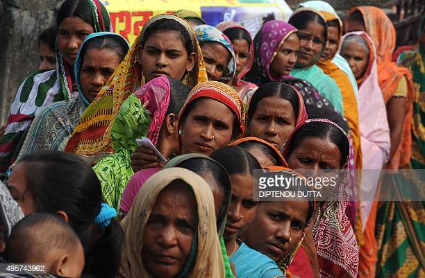 Indian female voters queue to cast their ballots at a voting centre in the final stage of state assembly elections in the Bihar village of Thakurganj...