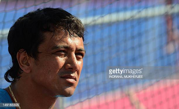 Indian field hockey captain Bharat Chetri looks on during a training session at the Old Loughtonians Hockey Club at Chigwell on the outskirts of...