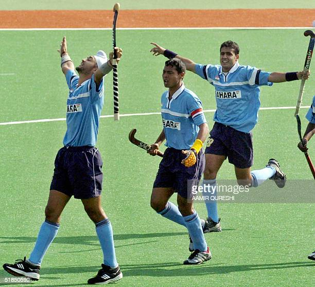 Indian field hockey players Sandeep Singh and team captain Dilip Tirkey celebrate the first goal against Pakistan during their men's Champions Trophy...