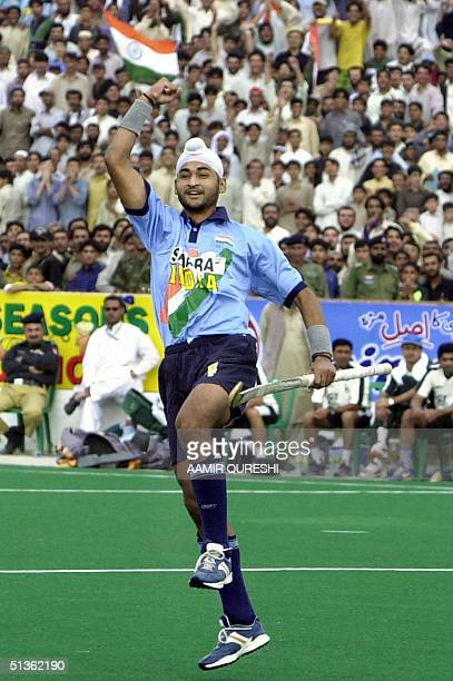 Indian field hockey team player Sandeep Singh celebrates first goal against Pakistan during the second field hockey match between Pakistan and India...