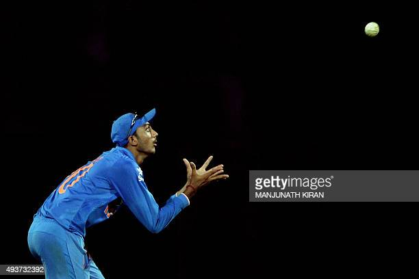 Indian fielder Axar Patel takes a catch to dismiss South African batsman Aaron Phangiso during the one day international cricket match between India...
