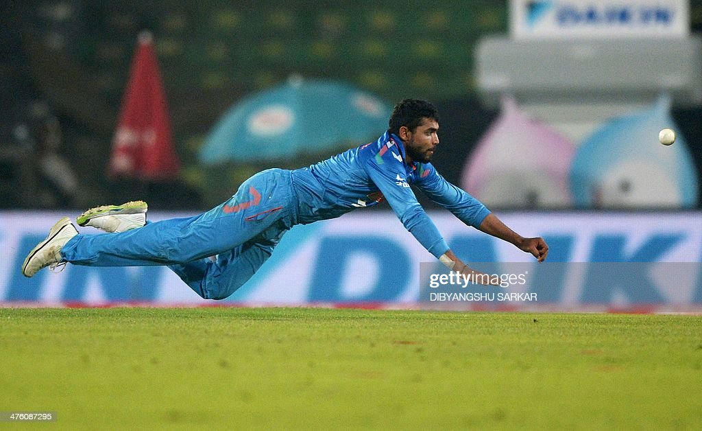 Indian fielder Ravindra Jadeja dives to stop a ball during the sixth match of the Asia Cup oneday cricket tournament between India and Pakistan at...