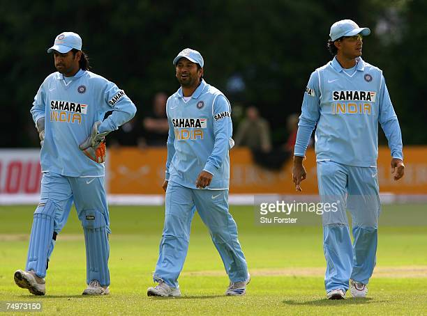 Indian fielders Sachin Tendulkar and Sourav Ganguly along with wicketkeeper Mahendra Singh Dhoni look on in disbelief after a decision is turned down...