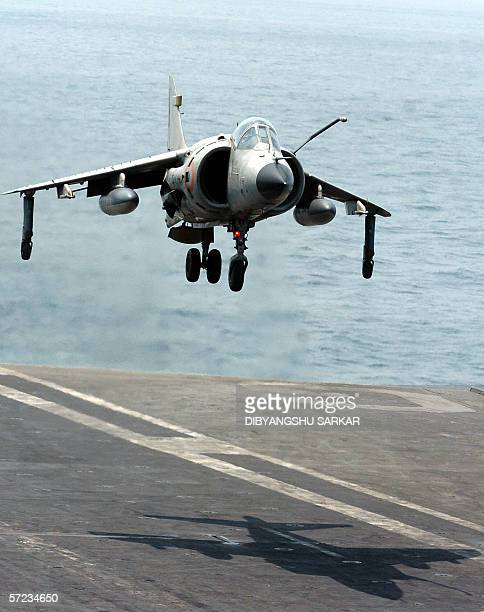 Indian fighter plane Sea Harrier performs a vertical landing on the French Aircraft Carrier warship Charles de Gaulle during the first day of joint...