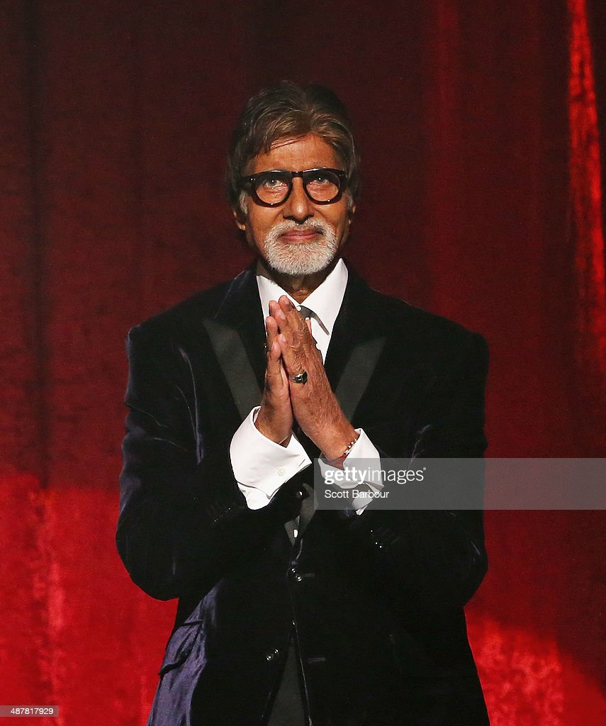 Indian film actor, <a gi-track='captionPersonalityLinkClicked' href=/galleries/search?phrase=Amitabh+Bachchan&family=editorial&specificpeople=220394 ng-click='$event.stopPropagation()'>Amitabh Bachchan</a> gestures on stage as he is presented with the International Screen Icon Award during the Indian Film Festival of Melbourne Awards at Princess Theatre on May 2, 2014 in Melbourne, Australia.