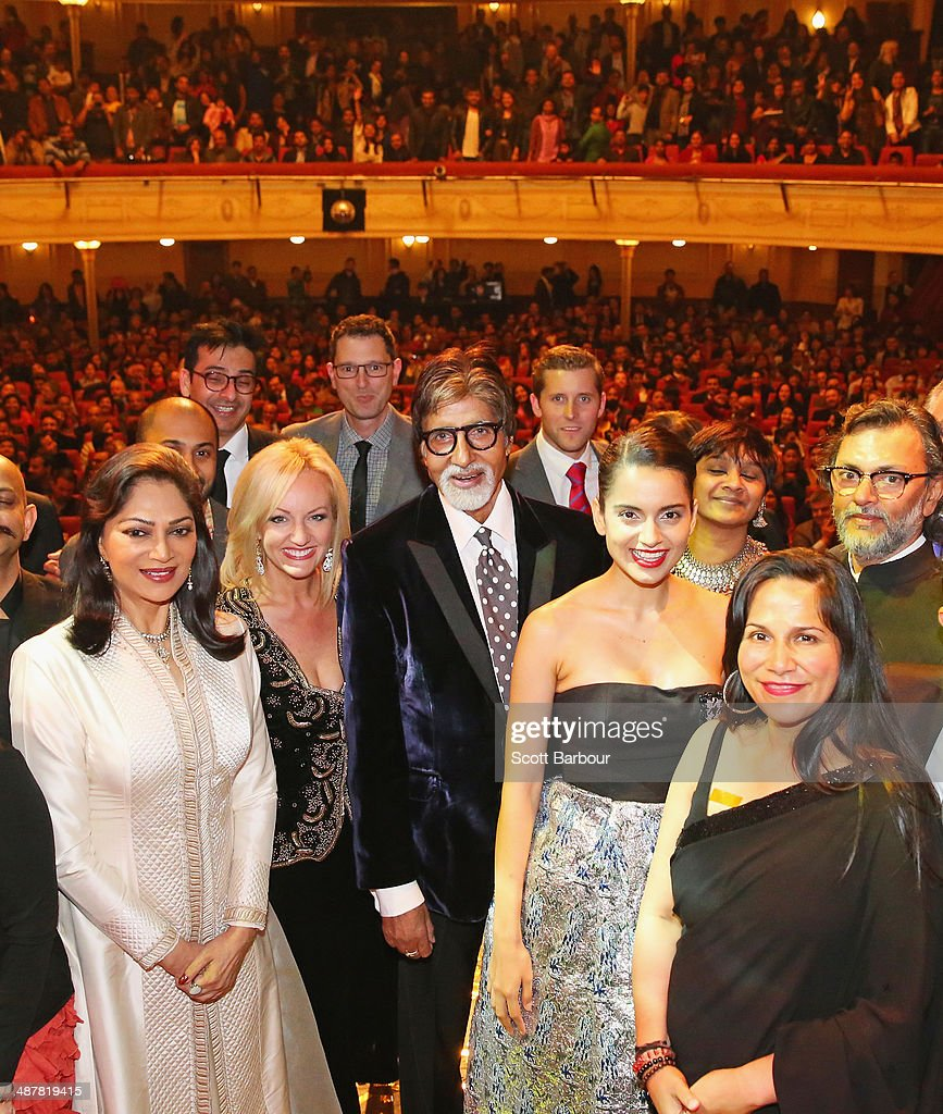 Indian film actor, <a gi-track='captionPersonalityLinkClicked' href=/galleries/search?phrase=Amitabh+Bachchan&family=editorial&specificpeople=220394 ng-click='$event.stopPropagation()'>Amitabh Bachchan</a> (C) poses with award winners including Indian actresses, <a gi-track='captionPersonalityLinkClicked' href=/galleries/search?phrase=Kangana+Ranaut&family=editorial&specificpeople=4325041 ng-click='$event.stopPropagation()'>Kangana Ranaut</a> and Simi Garewal and Indian filmmaker Rakeysh Omprakash Mehra during the Indian Film Festival of Melbourne Awards at Princess Theatre on May 2, 2014 in Melbourne, Australia.