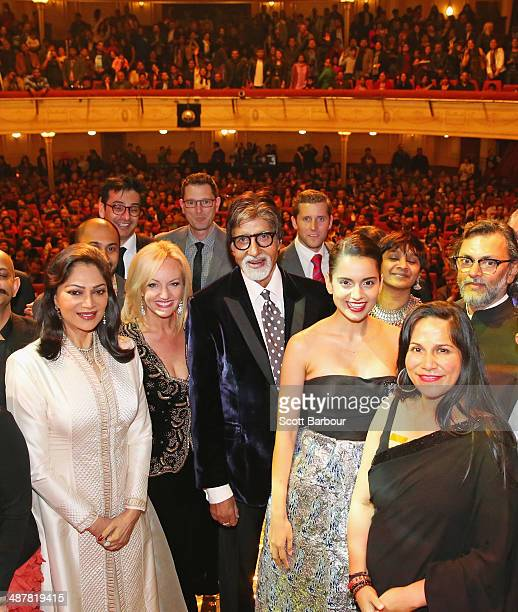 Indian film actor Amitabh Bachchan poses with award winners including Indian actresses Kangana Ranaut and Simi Garewal and Indian filmmaker Rakeysh...