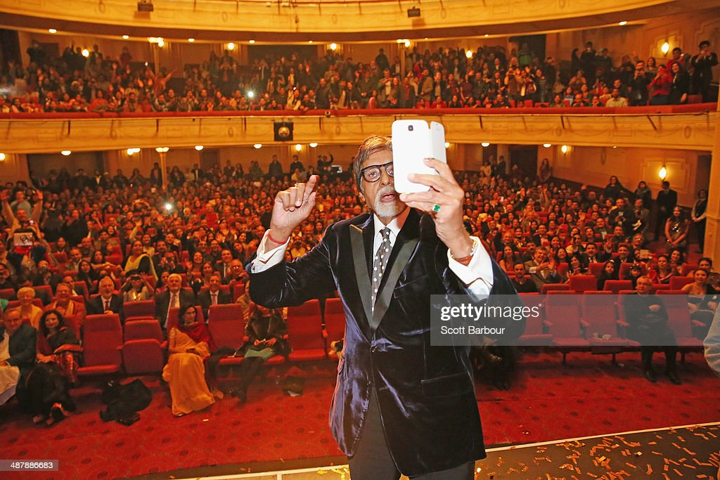 Indian film actor, <a gi-track='captionPersonalityLinkClicked' href=/galleries/search?phrase=Amitabh+Bachchan&family=editorial&specificpeople=220394 ng-click='$event.stopPropagation()'>Amitabh Bachchan</a> takes a photo with the crowd with his mobile phone on stage during the Indian Film Festival of Melbourne Awards at Princess Theatre on May 2, 2014 in Melbourne, Australia.