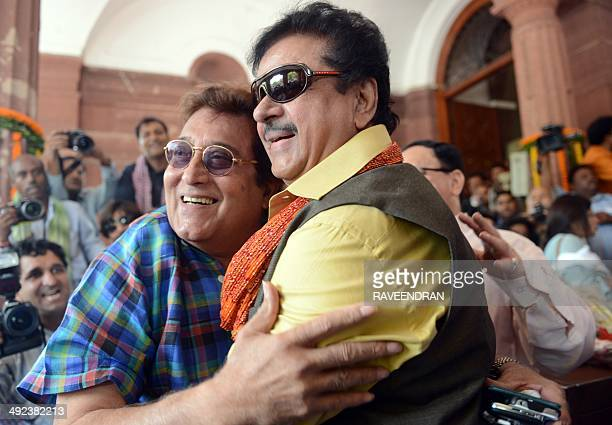 Indian film actors and Bharatiya Janata Party newly elected member of Parliaments Vinod Khanna and Shatrughan Sinha pose after arriving at parliament...