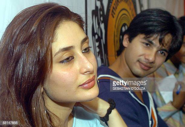 Indian film actress Kareena Kapoor is watched by fellow actor Shahid Kapoor as she speaks at the ceremonial launch of song recording of the film...