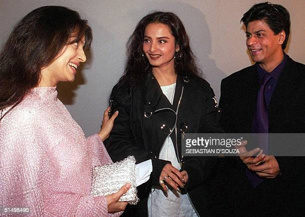 Indian film actresses Juhi Chawla and Rekha chat with Bollywood superstar Shah Rukh Khan at the launch of an entertainment website 14 November 2000...