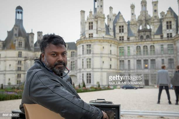Indian film director Gokul poses outside the Chateau of Chambord on October 5 2017 during the shooting of the Indian action film 'Junga' The film in...