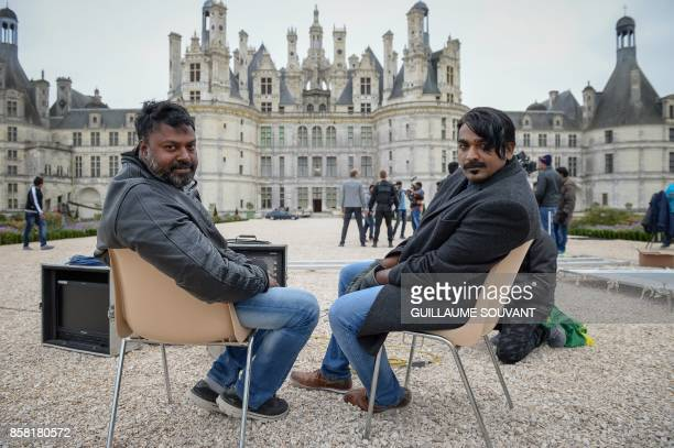 Indian film director Gokul poses with Indian actor Vijay Sethupathi outside the Chateau of Chambord on October 5 2017 during the shooting of the...