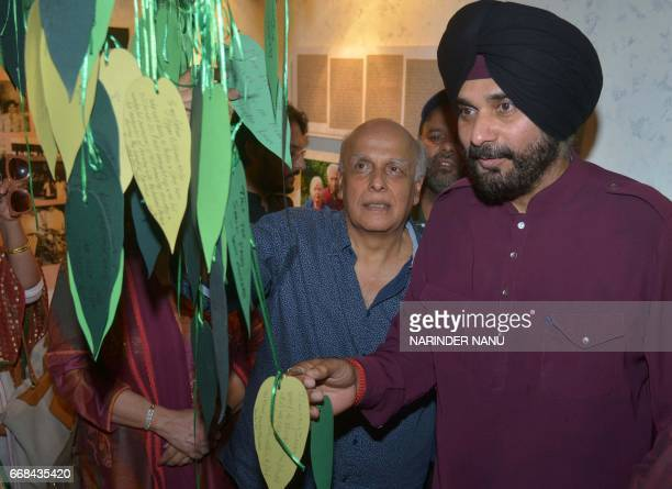 Indian film producer Mahesh Bhatt and cricketerturnedpolitician and Punjab Cabinet Minister Navjot Singh Sidhu take part in a promotional event for...