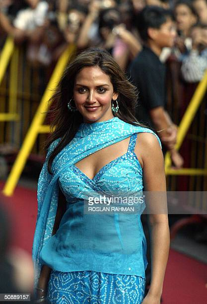 Indian film star actress Esha Deol poses for photographers upon arrival for the 5th International Indian Film Academy Premier in Singapore 20 May...