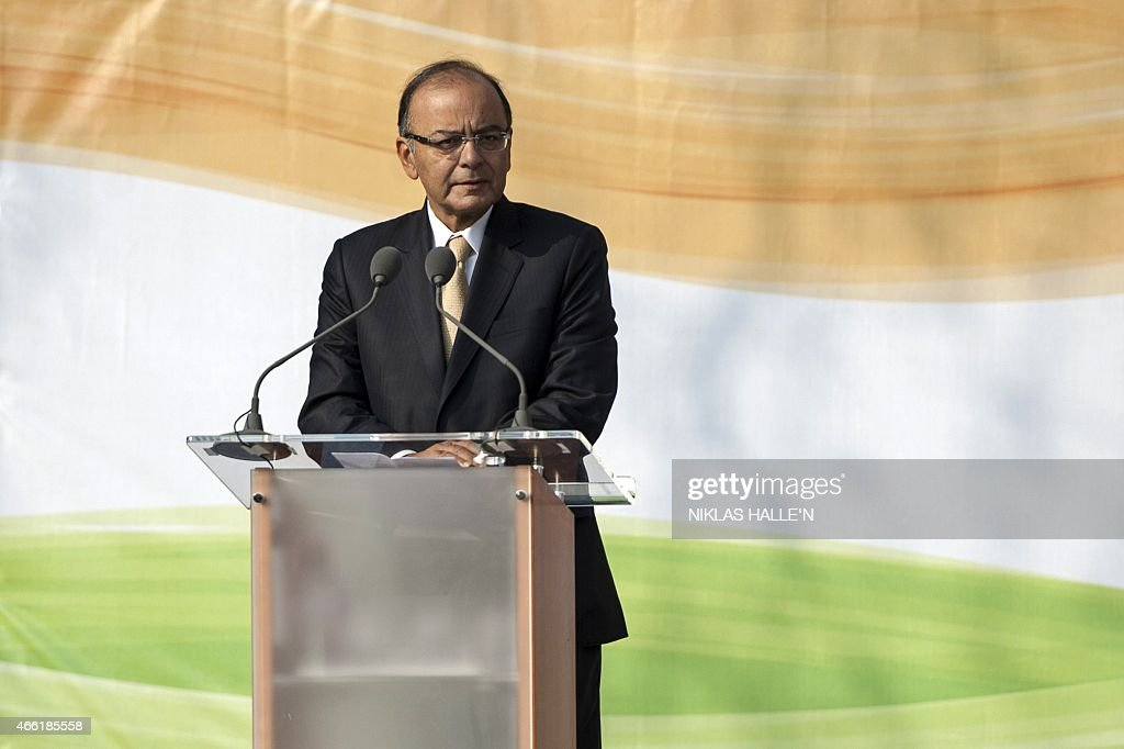 Indian finance minister <a gi-track='captionPersonalityLinkClicked' href=/galleries/search?phrase=Arun+Jaitley&family=editorial&specificpeople=2660950 ng-click='$event.stopPropagation()'>Arun Jaitley</a> delivers a speech during a ceremony unveiling a statue of Mahatma Gandhi in Parliament square in central London on March 14, 2015. Gandhi joins figures including Britain's World War II leader Winston Churchill, who described him as a half-naked 'fakir', in London's Parliament Square, opposite Big Ben and the House of Commons. AFP PHOTO / NIKLAS HALLE'N