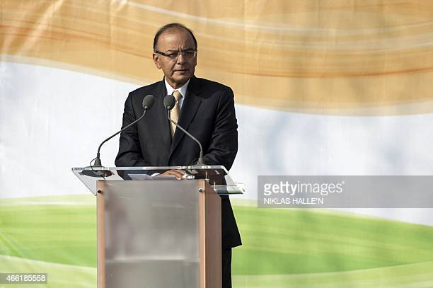 Indian finance minister Arun Jaitley delivers a speech during a ceremony unveiling a statue of Mahatma Gandhi in Parliament square in central London...