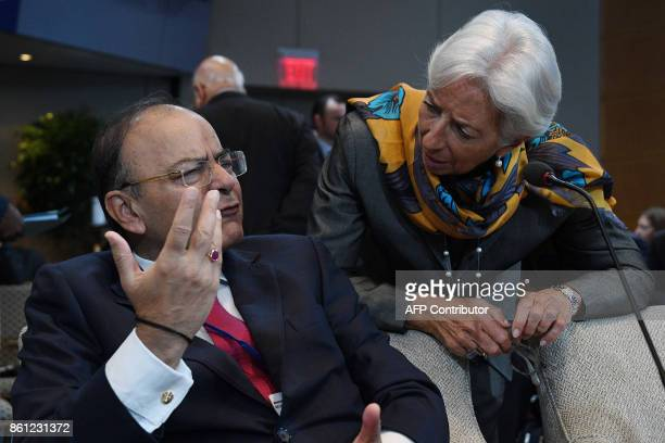 Indian Finance Minister Arun Jaitley talks with IMF Managing Director Christine Lagarde during a morning plenary session at the World Bank and...