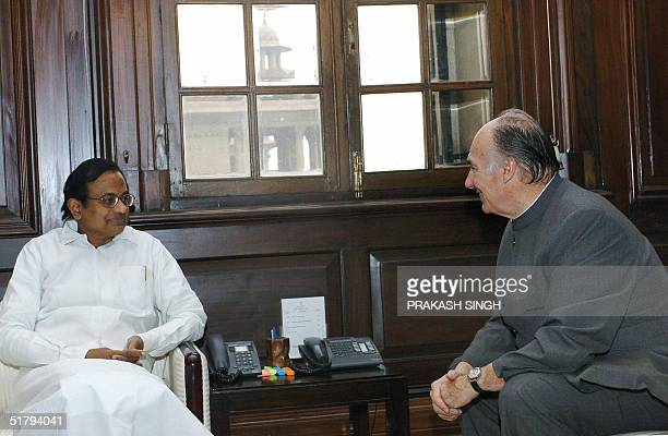 Indian Finance Minister P Chidambaram and His Highness The Aga Khan speak during a meeting in New Delhi 26 November 2004 The Aga Khan is in India on...
