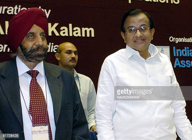 Indian Finance Minister PChidambaram and Chairman and Managing Director of the Punjab National Bank SS Kohli arrive for the second day of the 'Bancon...
