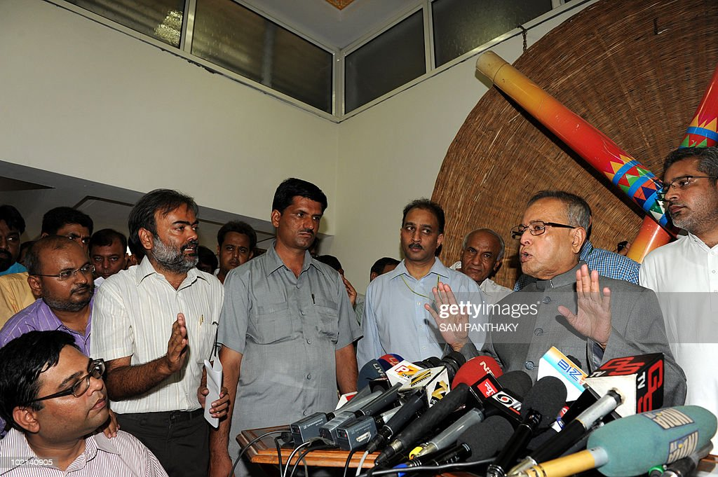 Indian Finance Minister Pranab Mukherjee (2nd R) talks to journalists at the Circuit House in Ahmedabad on June 16, 2010. Mukherjee is on a one-day visit to Gujarat state. AFP PHOTO/Sam PANTHAKY