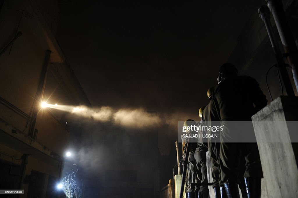 Indian firefighters attempt to control a fire that broke out at an electronics market in the old quarters of New Delhi on December 13, 2012. The fire was reported to be triggered by a short circuit in one of the shops in the congested market packed with outlets selling electrical equipment.