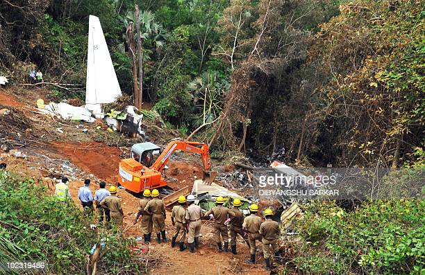 Indian firemen work at the plane crash site of the Air India Express Boeing 737800 in Mangalore on May 24 2010 Investigators combed the wreckage of...