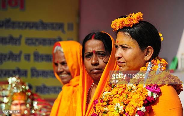 Indian first women Akhara's Pithadhishwar Jagat Guru Shankaracharya Shri Sadguru Trikaal Bhawanta stands with her disciples outside her Temple in...