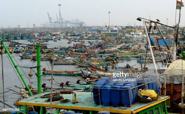 Indian fishermen carry out maintainance on mechanised boats in Chennai on May 24 2017 Authorities in the southern Indian state of Tamil Nadu have...