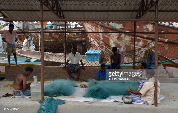 Indian fishermen repair nets at a harbour in Chennai on May 24 2017 Authorities in the southern Indian state of Tamil Nadu have imposed a 61 day ban...