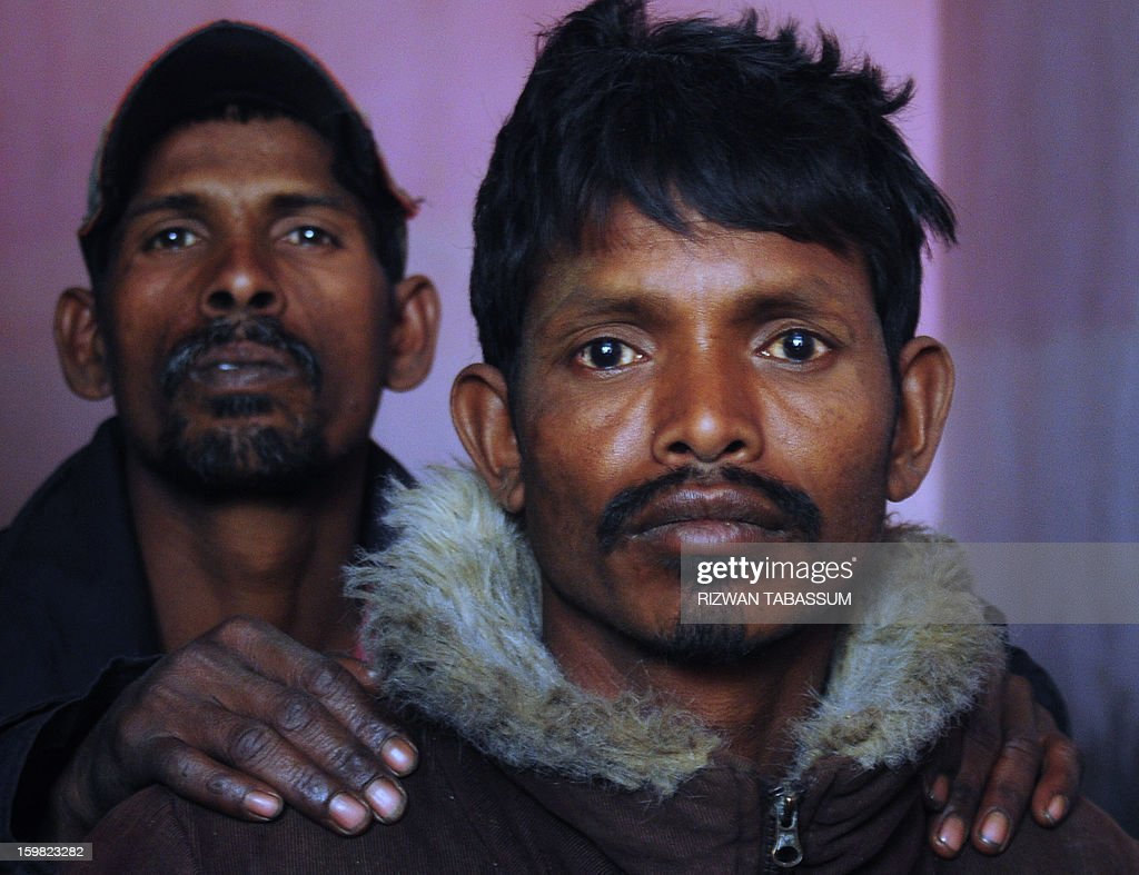 Indian fishermen sit at a police station following their arrest by the Maritime Security Agency in Karachi on January 21, 2013. Pakistan has arrested 27 Indian fishermen for illegally straying into its territorial waters, officials said. AFP PHOTO/ Rizwan TABASSUM