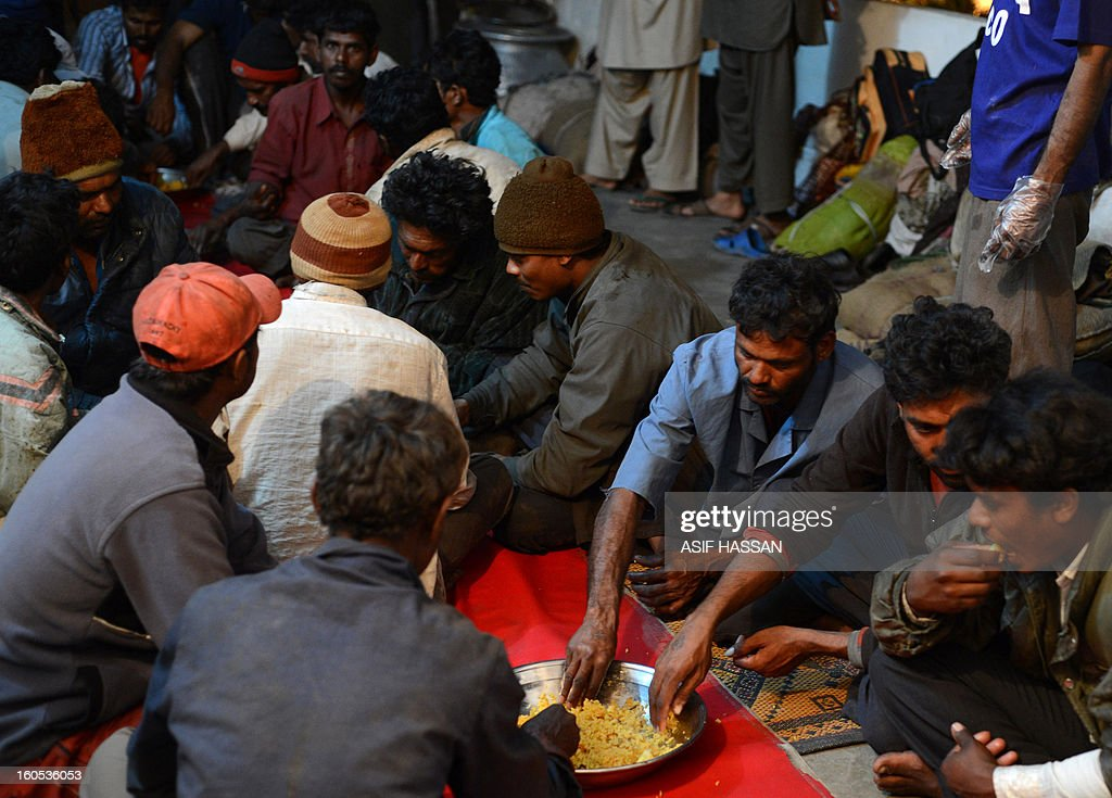 Indian fishermen, who were arrested for illegally fishing into Pakistan's territorial waters, eat dinner at a police station in Pakistan's port city of Karachi on February 2, 2013. Pakistan maritime security agency has arrested 54 Indian fishermen and seized nine boats for illegally fishing in Pakistan's territorial waters. AFP PHOTO/Asif HASSAN