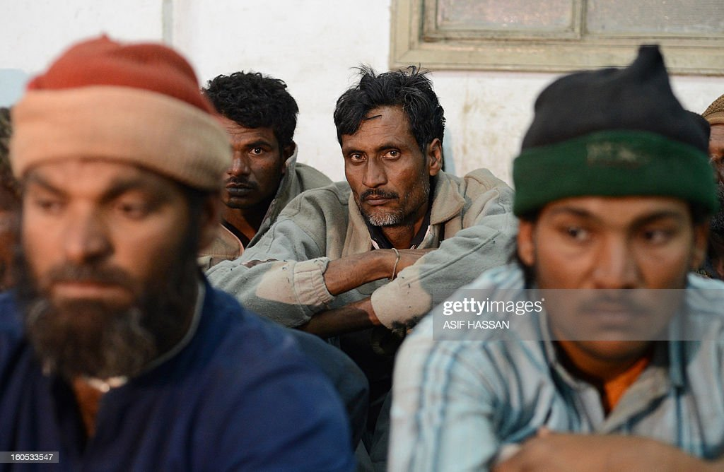 Indian fishermen, who were arrested for illegally fishing into Pakistan's territorial waters, sit at a police station in Pakistan's port city of Karachi on February 2, 2013. Pakistan maritime security agency has arrested 54 Indian fishermen and seized nine boats for illegally fishing in Pakistan's territorial waters. AFP PHOTO/Asif HASSAN