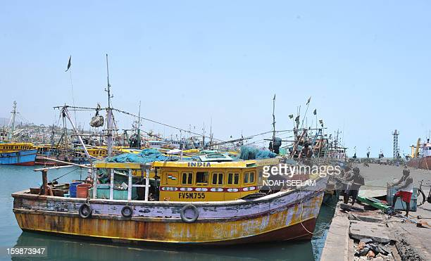 Indian fishermen work on the dockside at Visakhapatnam Fishing Harbour in Visakhapatnam on April 9 2012 The Visakhapatnam Port which was started in...
