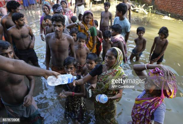 Indian flood effected villagers collect drinking water at Alal village in Malda district in the Indian state of West Bengal on August 23 2017 More...